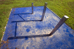 Horizontal bar. And its shadow on a playground Royalty Free Stock Photography