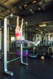 Horizontal bar workout. Fit adorable sports woman having workout using horizontal bar Royalty Free Stock Photography