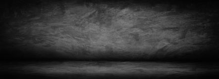 Horizontal black, dark and gray abstract cement wall and studio stock photography