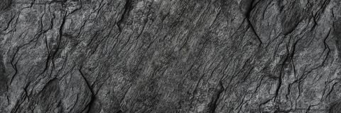 horizontal black stone texture for pattern and background Stock Photography