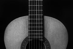 Guitar neck body and fret board with Strings. Horizontal Black and White Image of a Guitar neck, body and fret board with Strings Stock Images