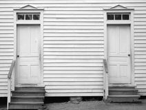 Old Church Entry Doors in Black and White. Horizontal black and white shot of very old entry doors on a hundred year old church. Lots of copy space Royalty Free Stock Photo