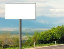Horizontal blank billboard for outdoor advertising next to the road royalty free stock image