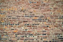 Horizontal brick pattern on vintage building. In the sun royalty free stock photography