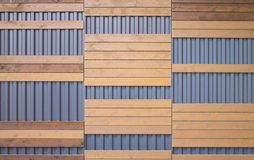 Horizontal brown wooden panel. On a blue metal background Stock Images