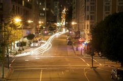 Horizontal of car head lights in downtown san francisco at night Stock Image