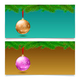 Horizontal Christmas banners. Fir tree branches with bright balls. Set of three horizontal Christmas and New Year banners. Fir tree branches on blurred Royalty Free Stock Photography