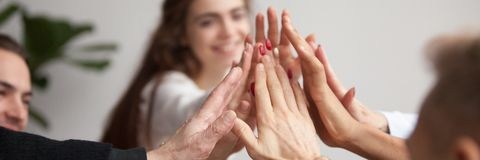 Horizontal closeup photo business team feels happy giving high five royalty free stock photos