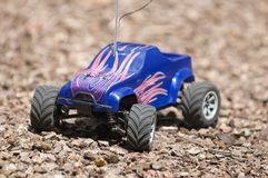 Horizontal close up of remote controlled electric truck. On bark Stock Photography