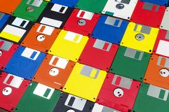 Floppy Disks Shot on Right Angle. Horizontal close-up right angled shot of a group of multicolored plastic diskettes.  Some fronts some backs Royalty Free Stock Photos