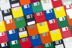 Floppy Disks Angled Left Close-up. Horizontal close-up shot of a group of multicolored plastic diskettes angled left Royalty Free Stock Photography