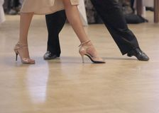 Graceful dance couple tangoing at the ballroom. royalty free stock photo