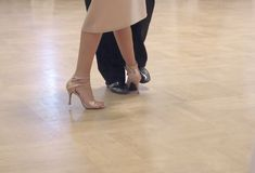 Graceful dance couple tangoing at the ballroom. stock photo