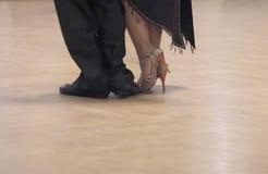 Graceful dance couple tangoing at the ballroom. stock image