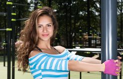 Horizontal closeup portrait of a beautiful young woman on the Playground. The woman grabs your hands post Royalty Free Stock Photography