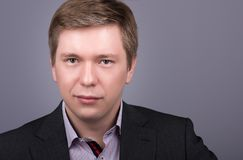 Horizontal closeup portrait young handsome man in jacket and shirt. Neutral grey background Royalty Free Stock Photo