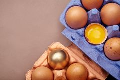 Сloseup shot with two colorful cardboard containers of pink and violet color with chicken eggs Royalty Free Stock Images