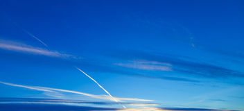 Horizontal clouds on a blue evening sky. Horizontal clouds on a blue sky Royalty Free Stock Photo