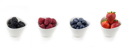 Horizontal collection of berries in bowls Royalty Free Stock Image
