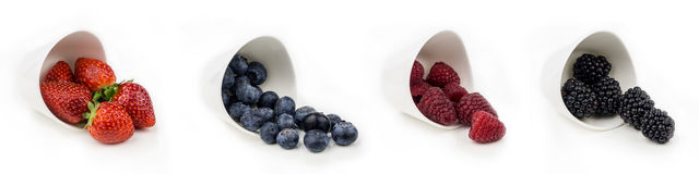 Horizontal collection of berries in bowls Stock Photos