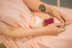 Creative knitting hobby. Horizontal composition. Lovely warm mood toned craft photo Royalty Free Stock Photos