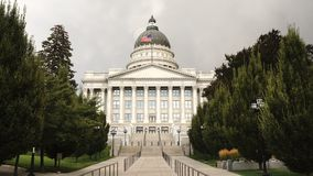 A horizontal composition state capital building in Salt Lake City. Flag Flying Utah Capital Building Strong Wind Salt Lake City stock footage