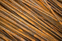 Horizontal CU of thin smooth semi-rusty steel bars stacked in a diagonal position Royalty Free Stock Images