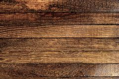 Horizontal dark wooden table background. Top view. Copy space. Horizontal dark wooden table background. Old brown burnt oak. Top view. Copy space. Close up stock photos