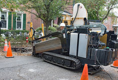 Horizontal Directional Drill in Use. Dayton, Ohio, USA - October 25, 2016: Worker operates a horizontal directional drill to drill underground tunnels for new stock photography