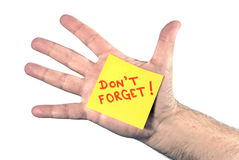 Horizontal DON'T FORGET Note On Hand. Close up shot of a male hand with DON'T FORGET! sticky note in palm Royalty Free Stock Image