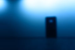 Horizontal door bokeh with blue light glow background Royalty Free Stock Image