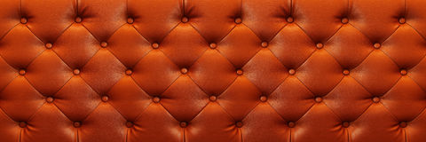 Horizontal elegant brown leather texture with buttons for backgr Stock Photography