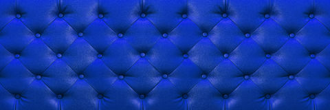 Horizontal elegant dark blue leather texture with buttons for ba Stock Photography