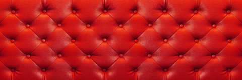 Horizontal elegant red leather texture with buttons for backgrou Royalty Free Stock Photo