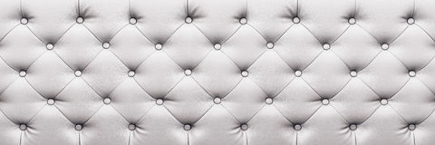 Horizontal elegant white leather texture with buttons for backgr Royalty Free Stock Image