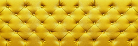 Horizontal elegant yellow leather texture with buttons for backg Stock Image
