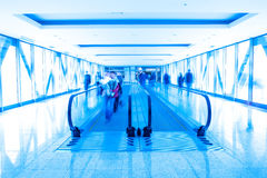 Horizontal escalator and moving people Stock Images