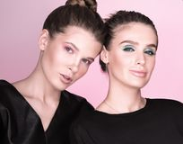 Horizontal fashion portrait. Two young beautiful women in black Royalty Free Stock Images