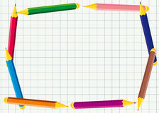 Horizontal frame of colored pencils on notebook sheet Royalty Free Stock Image