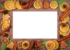 Horizontal frame composed of dried oranges, lemons, mandarins, anise stars, cinnamon sticks and on background of brown fabric Royalty Free Stock Photography
