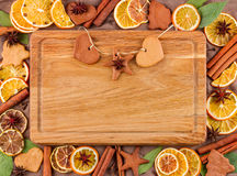 Horizontal frame composed of dried oranges, lemons, mandarins, anise stars, cinnamon sticks and on a brown background Royalty Free Stock Photos