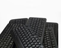 A few black computer keyboards. Keyboards for PC stock images