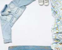 Horizontal frame of jeans stuff and sneakers for baby boy on whi Royalty Free Stock Photos