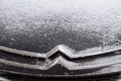 Horizontal front view of Citroen logo covered in snow Stock Images