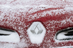 Horizontal front view of Renault logo covered in snow Stock Photography