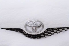 Horizontal front view of Toyota logo covered in snow Royalty Free Stock Photos