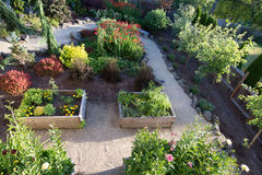 Horizontal Garden Path. Looking down on a path curving between flowers in a perennial garden stock images