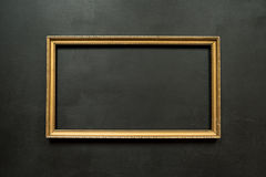 Horizontal gold thin picture frame on black Royalty Free Stock Image