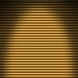 Horizontal gold tube background lit from overhead Royalty Free Stock Images