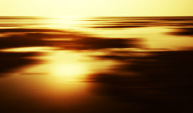 Horizontal golden sunset landscape horizon motion. Abstraction background backdrop stock photo